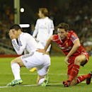 Real Madrid's James Rodriguez, left, holds his face after taking a knock in a challenge with Liverpool's Joe Allen during the Champions League group B soccer match between Liverpool and Real Madrid at Anfield Stadium, Liverpool, England, Wednesday Oct. 22