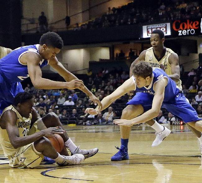 Vanderbilt forward James Siakam, bottom, tries to protect the ball from Saint Louis defenders Dwayne Evans, second from left, and Rob Loe, front right, in the second half of an NCAA college basketball game Monday, Dec. 30, 2013, in Nashville, Tenn. Saint Louis won 57-49