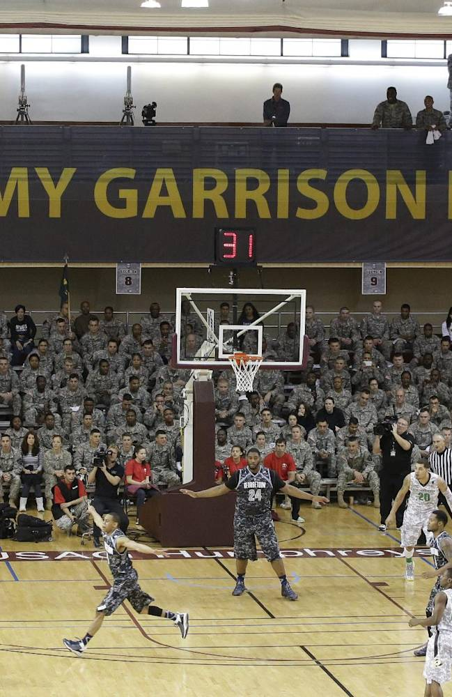 CORRECTS SPELLING OF CITY TO PYEONGTAEK - U.S. Army personnel watch the NCAA college basketball game between Oregon and Georgetown during the second half in the Armed Forces Classic at Camp Humphreys in Pyeongtaek, south of Seoul, South Korea, Saturday, Nov. 9, 2013