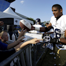 St. Louis Rams defensive end Michael Sam signs autographs for fans following practice at the NFL football team's training camp facility Tuesday, July 29, 2014, in St. Louis The Associated Press