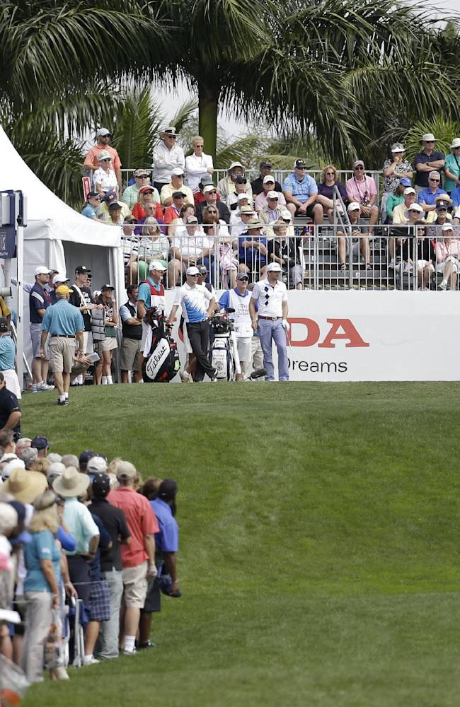 Tiger Woods tees off on the first hole during the second round of the Honda Classic golf tournament, Friday, Feb. 28, 2014, in Palm Beach Gardens, Fla