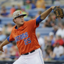 Florida pitcher Eric Hanhold delivers against Vanderbilt during the first inning of a Southeastern Conference NCAA college baseball tournament championship game Sunday, May 24, 2015, in Hoover, Ala. (AP Photo/Brynn Anderson)