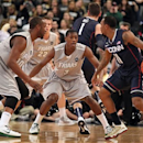 Providence guard Kris Dunn (3) and forward Kadeem Batts (10) defend against Connecticut guard Ryan Boatright (11) during the first half of an NCAA college basketball game, Thursday, Jan. 31, 2013, in Providence, R.I. (AP Photo/Stew Milne)