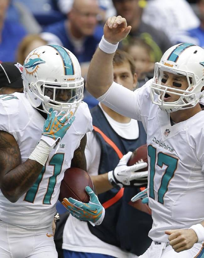 Miami Dolphins' Ryan Tannehill (17) celebrates with Mike Wallace (11) after Wallace scored on an 18-yard touchdown reception during the first half an NFL football game against the Indianapolis Colts Sunday, Sept. 15, 2013, in Indianapolis