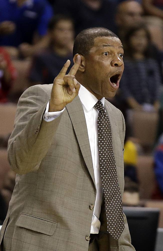 The Los Angeles Clippers head coach Doc Rivers instructs his team during the second half of a preseason NBA basketball game against the Denver Nuggets on Saturday, Oct. 19, 2013, in Las Vegas. The Clippers defeated the Nuggets in overtime 118-111