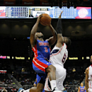 Detroit Pistons guard Rodney Stuckey (3) is fouled by Atlanta Hawks guard Shelvin Mack (8) during the second period of an NBA basketball game in Atlanta, Tuesday, April 8, 2014. The Pistons won the game 102-95 The Associated Press