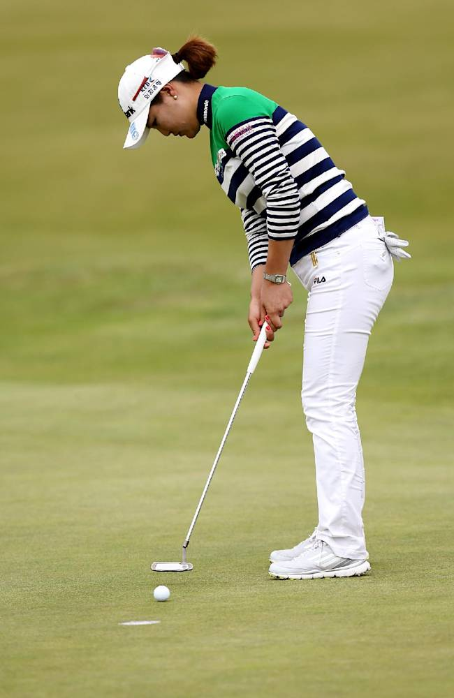 South Korea's So Yeon Ryu putts on the 18th green during the third day of the Women's British Open golf championship at the Royal Birkdale Golf Club, Southport, England, Saturday July 12, 2014