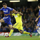 Chelsea's Nemanja Matic, right, vies for the ball with Maribor's Tavares, center, during the Champions League Group G soccer match between Chelsea and NK Maribor at Stamford Bridge stadium in London Tuesday, Oct. 21, 2014