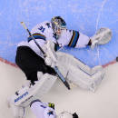 San Jose Sharks goalie Antti Niemi, of Finland, block a shot during the third period in Game 3 of an NHL hockey first-round playoff series against the Los Angeles Kings, Tuesday, April 22, 2014, in Los Angeles. (AP Photo/Mark J. Terrill)