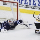 Winnipeg Jets goaltender Michael Hutchinson (34) makes a save on Boston Bruins' Brad Marchand (63) during the shootout of an NHL hockey game Thursday, April 10, 2014, in Winnipeg, Manitoba. The Jets won 2-1 The Associated Press