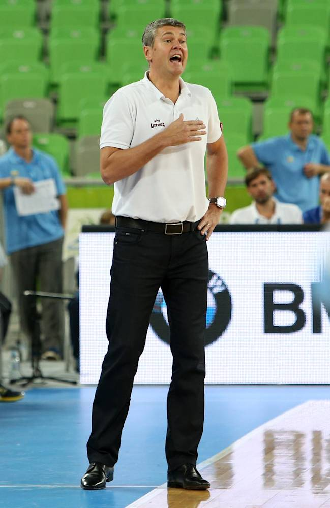 Latvia's coach Ainars Bagatskis gives directions to his players during their EuroBasket European Basketball Championship Group E match against Ukraine at the Stozice Arena, in Ljubljana, Slovenia, Wednesday, Sept. 11, 2013