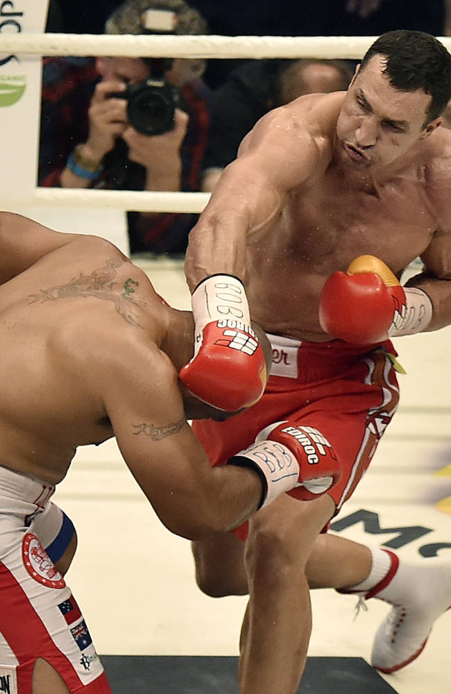 World boxing champion Wladimir Klitschko of Ukraine, right, fights Samoan-born Australian challenger Alex Leapai during their IBF, IBO, WBO and WBA heavyweight title bout in Oberhausen, Germany, Saturday, April 26, 2014. Klitschko won the fight by technical knock out in the fifth round