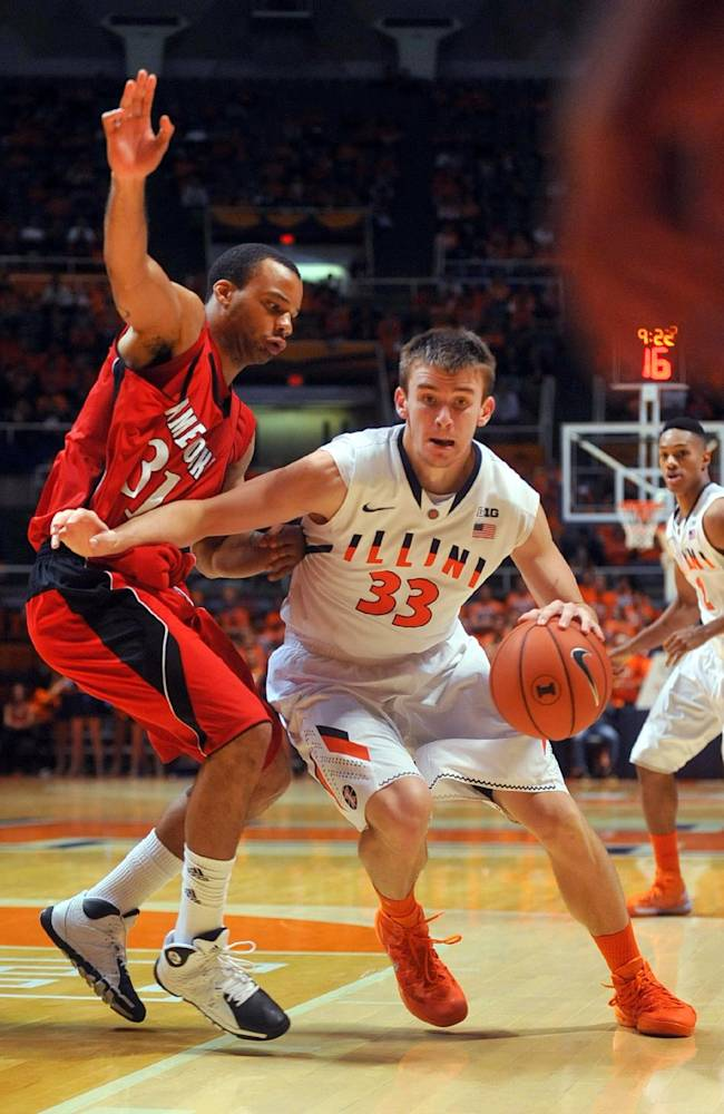 Illinois forward Jon Ekey (33) drives to get around Jacksonville State guard/forward Teraes Clemmons (31) in the second half in an NCAA college basketball game Sunday, Nov. 10, 2013, in Champaign, Ill