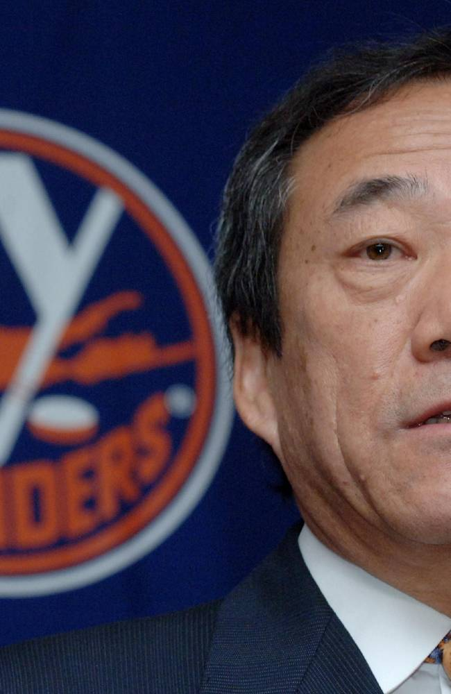 In this Jan. 12, 2006, file photo, New York Islanders' owner Charles Wang speaks during a news conference in Uniondale, New York. The Islanders have announced that the team is being sold to a former Washington Capitals co-owner and a London-based investor. In a statement Tuesday, Aug. 19, 2014, the team says a group led by former Capitals co-owner Jon Ledecky and investor Scott Malkin has reached an agreement to buy a