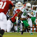 Oregon wide receiver Darren Carrington (87) runs downfield with a South Dakota defender's arms wrapped around him during the second quarter of an NCAA college football game in Eugene, Ore., Saturday, Aug. 30, 2014 The Associated Press
