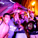 MIAMI, FL - JUNE 20: Fans celebrate in the streets after the Miami Heat won the NBA title against the San Antonio Spurs on June 20, 2013 in Miami, Florida. The Heat have won back to back championships. (Photo by Joe Raedle/Getty Images)
