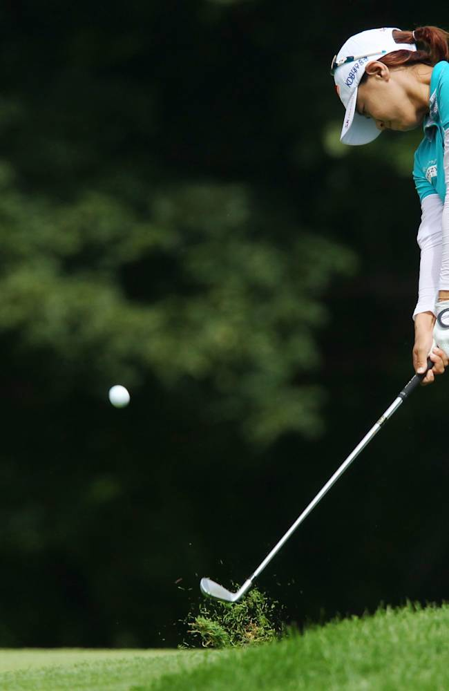 Na Yeon Choi, of South Korea, hits a fairway shot on the ninth hole during final-round play at the Canadian Pacific Women's Open golf tournament in London, Ontario, Sunday, Aug. 24, 2014