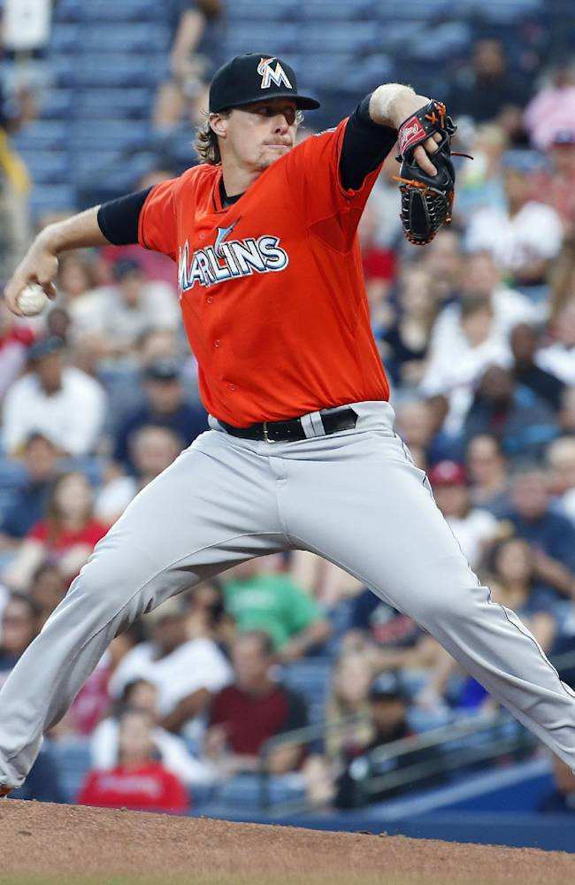Miami Marlins starting pitcher Tom Koehler works against the Atlanta Braves in the first inning of a baseball game Monday, April 21, 2014 in Atlanta
