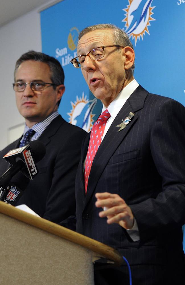 Miami Dolphins owner Stephen Ross, right, and CEO Tom Garfinkel address the media before an NFL football game against the Tampa Bay Buccaneers Monday, Nov. 11, 2013, in Tampa, Fla