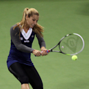 Dominika Cibulkova of Slovakia returns the ball to Alisa Kleybanova of Russia during the second day of the WTA Qatar Ladies Open in Doha, Qatar,Tuesday Feb. 11, 2014. (AP Photo/Osama Faisal)