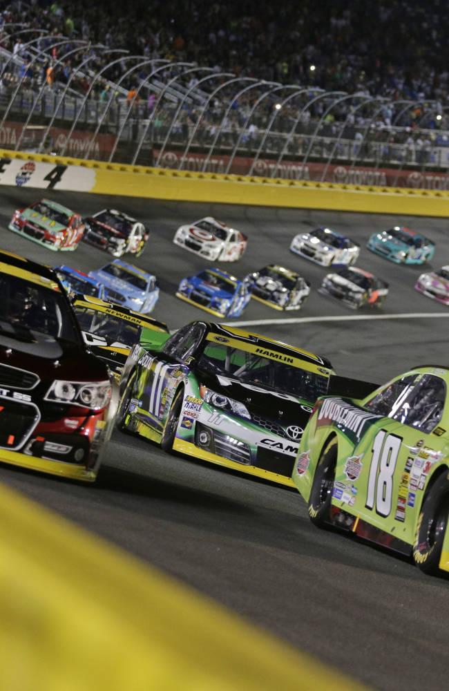 Harvick moves into 3rd round with win at Charlotte