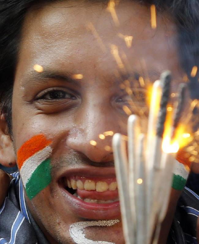 A fan of Indian cricketer Sachin Tendulkar lights fieworks outside Wankhede Stadium, to pay tribute to Tendulkar who retired Saturday in Mumbai, India, Saturday, Nov. 16, 2013. Tendulkar's last day featured a cameo appearance bowling for a couple of overs, and a guard of honor from teammates as he walked from the field for the last time. He compiled more runs and posted more centuries in international cricket than anyone, and was the greatest batsman of his generation