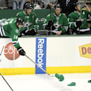 Dallas Stars left wing Jamie Benn (14) picks up a hat off the ice after center Tyler Seguin's (91) hat-trick in the second period during an NHL hockey game against the Philadelphia Flyers, Saturday, Dec. 7, 2013 in Dallas The Associated Press