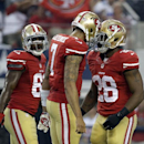 San Francisco 49ers wide receiver Anquan Boldin (81) watches as Colin Kaepernick (7) and Carlos Hyde (28) celebrate a first down in the first half of an NFL football game against the Dallas Cowboys, Sunday, Sept. 7, 2014, in Arlington, Texas The Associate