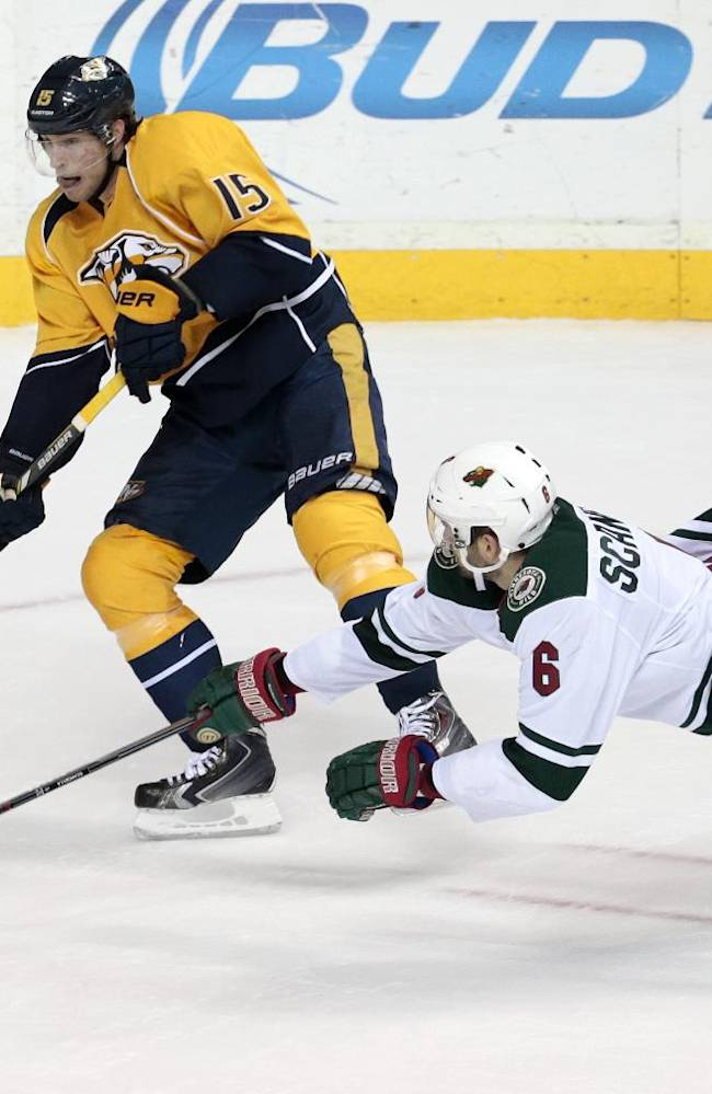 Minnesota Wild defenseman Marco Scandella (6) tries to block a shot by Nashville Predators forward Craig Smith (15) in the second period of an NHL hockey game Sunday, Jan. 12, 2014, in Nashville, Tenn