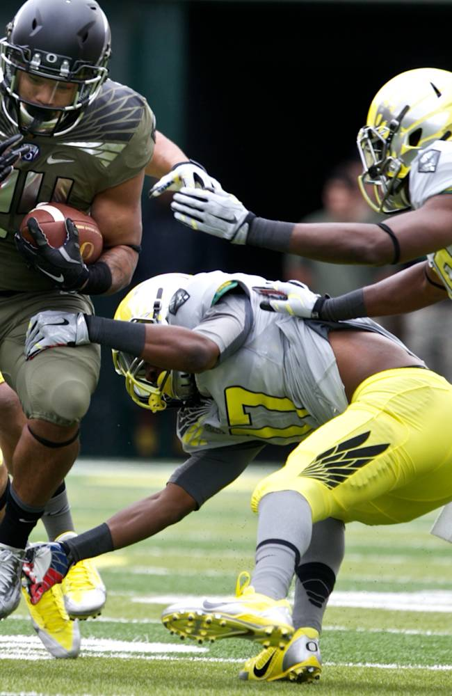 Oregon's Thomas Tyner runs the ball during the Ducks spring NCAA college football game on Saturday, May 3, 2014, at Autzen Stadium in Eugene, Ore