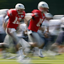 New England Patriots quarterback Tom Brady, center left, and quarterback Ryan Mallett, center right, warm up during an NFL football training camp in Foxborough, Mass., Saturday, July 26, 2014. (AP Photo) The Associated Press