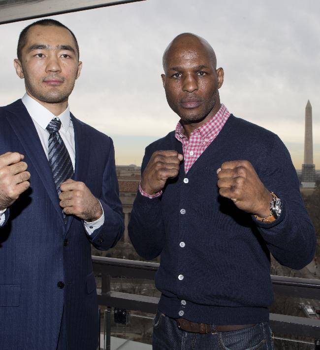 IBF Light Heavyweight World Champion Bernard Hopkins, left, and WBA and IBA Light Heavyweight Champion Beibut Shumenov of Kazakhstan, pose during a news conference in Washington, Tuesday, March 11, 2014, announcing their Light Heavyweight World Championship unification bout to be held at the DC Armory in Washington on April 19, 2014. The Washington Monument, can be seen from the background