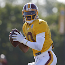 Washington Redskins quarterback Robert Griffin III looks to pass during practice at the team's NFL football training facility, Monday, July 28, 2014 in Richmond, Va The Associated Press