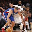 Dominican Republic forward Francisco Garcia, left, and U.S. guard Kyrie Irving chase a loose ball during the first half of an exhibition basketball game at Madison Square Garden in New York, Wednesday, Aug. 20, 2014. (AP Photo/Kathy Willens)