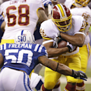 Washington Redskins running back Alfred Morris, right, is tackled by Indianapolis Colts inside linebacker Jerrell Freeman during the first half of an NFL football game Sunday, Nov. 30, 2014, in Indianapolis The Associated Press