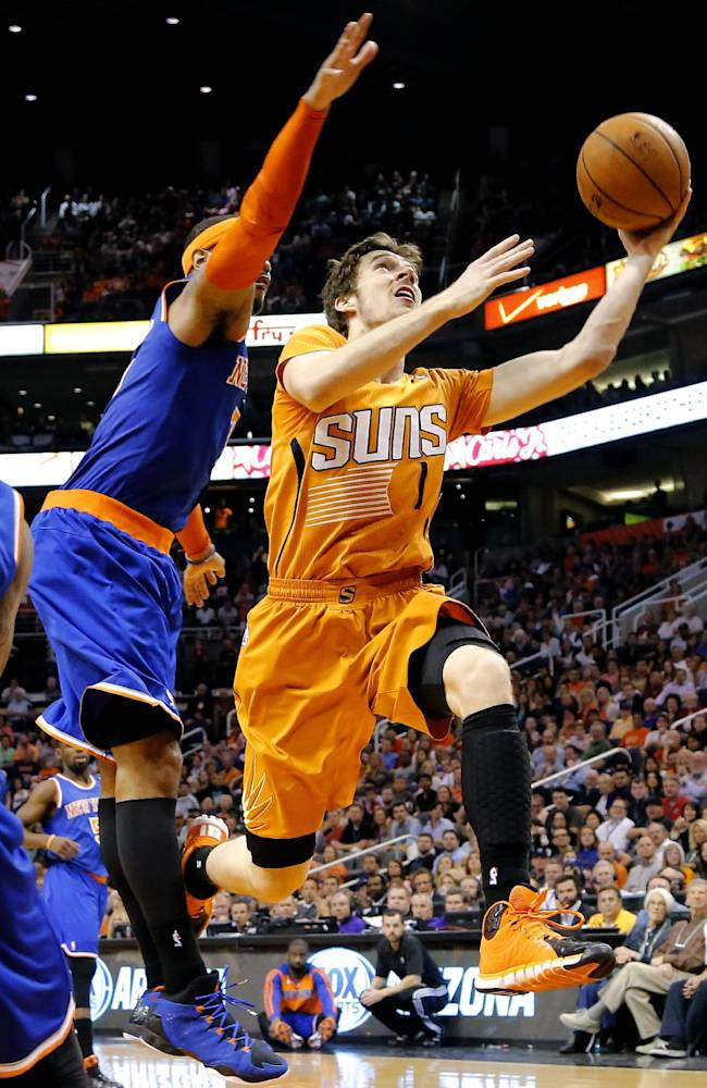 In this March 28, 2014 file photo, Phoenix Suns' Goran Dragic (1), of Slovenia, drives past New York Knicks' Carmelo Anthony during the second half of an NBA basketball game, in Phoenix. Dragic was selected Wednesday, April 23, 2014 as the league's Most Improved Player