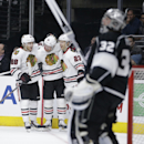 Chicago Blackhawks' Patrick Kane(88), Brad Richards(91) and Kris Versteeg(23) celebrate a goal by Richards as Los Angeles Kings goalie Jonathan Quick, foreground, stands on the ice during the first period of an NHL hockey game Saturday, Nov. 29, 2014, in