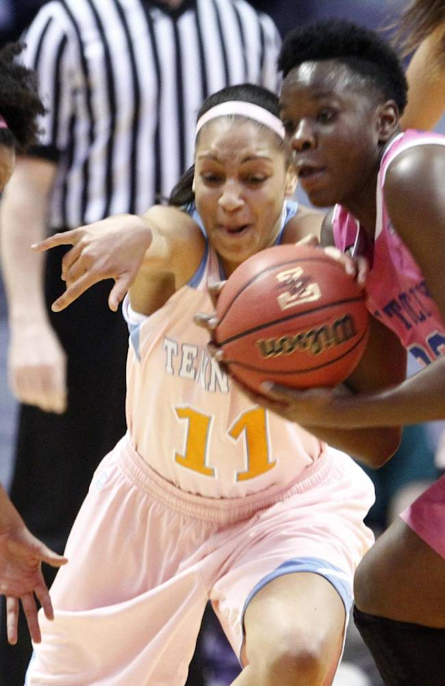 Tennessee forward Cierra Burdick (11) battles for the ball with Kentucky's Samarie Walker, right, and guard Kastine Evans (32) in the first half of an NCAA college basketball game on Sunday, Feb. 16, 2014, in Knoxville, Tenn