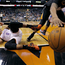 Oklahoma City Thunder guard Russell Westbrook (0) falls as Phoenix Suns' P.J. Tucker reaches for the ball as it goes out of bounds during the second half of an NBA basketball game, Thursday, March 6, 2014, in Phoenix The Associated Press