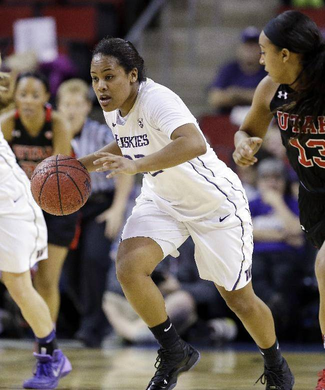 Washington's Jazmine Davis, center, leads a drive up court with Utah's Devri Owens (13) in the first half of an NCAA college basketball game in the Pac-12 women's tournament Thursday, March 6, 2014, in Seattle