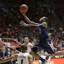 Arizona's Mark Lyons (2) goes to the basket as Utah's Glen Dean (1) falls in the second half during an NCAA college basketball game on Sunday, Feb. 17, 2013, in Salt Lake City. Arizona defeated Utah 68-64. (AP Photo/Rick Bowmer)
