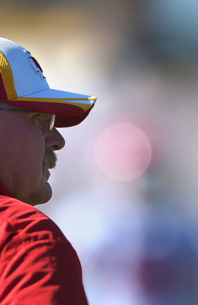 Kansas City Chiefs head coach Andy Reid watches his players during NFL football training camp Tuesday morning, Aug. 12, 2014, in St. Joseph. Mo