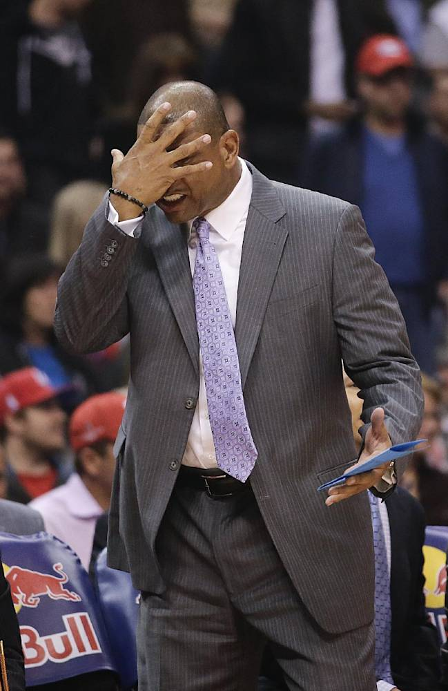 Los Angeles Clippers' Doc Rivers reacts while directing his team during the first half of an NBA basketball game against the Brooklyn Nets on Saturday, Nov. 16, 2013, in Los Angeles