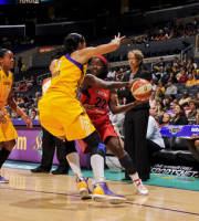 LOS ANGELES, CA - JUNE 18: Matee Ajavon #22 of the Washington Mystics looks to pass the ball against Candace Parker #3 of the Los Angeles Sparks at the Staples Center on June 18, 2012 in Los Angeles, California.  (Photo by Juan Ocampo/NBAE via Getty Images)