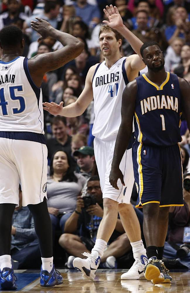 Dallas Mavericks power forward Dirk Nowitzki (41) of Germany celebrates with center DeJuan Blair (45) after drawing a foul by Indiana Pacers' Lance Stephenson (1) during the second half of an NBA game, Sunday, March 9, 2014, in Dallas, Texas. The Dallas Mavericks won 105-94