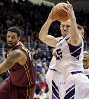 Northwestern forward Nikola Cerina, right, rebounds the ball against Minnesota forward Maurice Walker during the first half of an NCAA college basketball game in Evanston, Ill., Sunday, Feb. 16, 2014. (AP Photo/Nam Y. Huh)