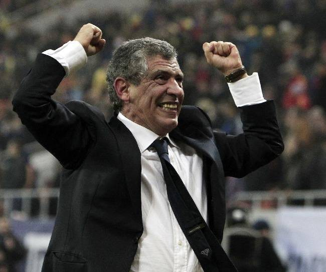 In this Tuesday, Nov. 19, 2013 file photo, Fernando Santos, the coach of Greece, celebrates after defeating Romania in their World Cup qualifying playoff second leg match at the National Arena in Bucharest. Greece's Football Association said Thursday Feb. 27, 2014, that national coach Fernando Santos will step down following the World Cup in Brazil, after a successful four-year term on the job that saw the country rise to 12th place in the the FIFA world rankings