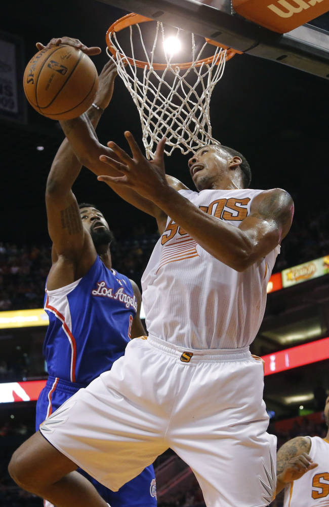 Los Angeles Clippers' DeAndre Jordan, rear, defends as Phoenix Suns' Channing Frye pulls down a rebound during the first half of an NBA basketball game, Tuesday, March 4, 2014, in Phoenix