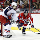 Washington Capitals right wing Troy Brouwer (20) goes for the puck with Columbus Blue Jackets defenseman Fedor Tyutin (51), of Russia, defending, in the first period of an NHL hockey game Tuesday, Nov. 12, 2013, in Washington The Associated Press