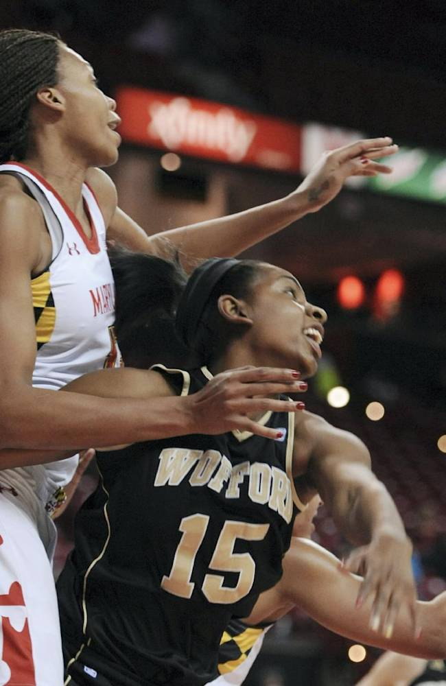 Maryland's Alicia DeVaughn, left, and Wofford's Ashton Fleming reach for a rebound in the second half of an NCAA college basketball game Saturday, Dec. 28, 2013 in College Park, Md. Maryland won 110-53